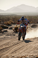 3x KTM motorcycle of Kurt Caselli/Ivan Ramirez pass race mile 58 in 2012 San Felipe Baja 250, San Felipe, Baja California, Mexico. 1st place motorcycle finishers