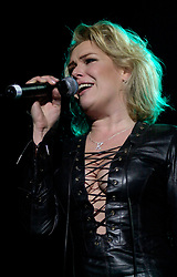 Kim Wilde steps out of the her TV Gardening clothes and Back on Stage to Tour with<br /><br />Steve Starnge (Visage)<br />Claire Grogan (Altered Images)<br />The Belle Stars<br />Dollar<br />The Human League<br />Play on the Here and Now  Christmas Party Tour at Sheffields Hallam FM Arena Friday 13th December 2002<br /><br />[#Beginning of Shooting Data Section]<br />Nikon D1 <br />2002/12/13 22:24:45.3<br />JPEG (8-bit) Fine<br />Image Size:  2000 x 1312<br />Color<br />Lens: 80-200mm f/2.8-2.8<br />Focal Length: 80mm<br />Exposure Mode: Manual<br />Metering Mode: Spot<br />1/200 sec - f/2.8<br />Exposure Comp.: 0 EV<br />Sensitivity: ISO 800<br />White Balance: Auto<br />AF Mode: AF-S<br />Tone Comp: Normal<br />Flash Sync Mode: Not Attached<br />Color Mode: <br />Hue Adjustment: <br />Sharpening: Normal<br />Noise Reduction: <br />Image Comment: <br />[#End of Shooting Data Section]