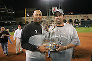 HOUSTON - OCTOBER 26:  Harold Baines and Ozzie Guillen hold the World Series Trophy after Game 4 of the 2005 World Series against the Houston Astros at Minute Maid Park on October 26, 2005 in Chicago, Illinois.  The White Sox defeated the Astros 1-0.