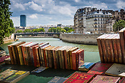 The Bouquinistes of Paris are booksellers of used and antiquarian books who ply their trade along large sections of the banks of the Seine: on the right bank from the Pont Marie to the Quai du Louvre, and on the left bank from the Quai de la Tournelle to Quai Voltaire. The Seine is thus described as 'the only river in the world that runs between 2 bookshelves'.  The tradition of the second-hand booksellers began around the 16th century with little market peddlers. Under pressure from booksellers, a settlement of 1649 prohibited stalls and the display of books on the Pont Neuf. The authorities at the time were rather anxious to limit parallel markets not subjected to official censorship. Travelling booksellers during the period were driven out and then reinstated under approval.