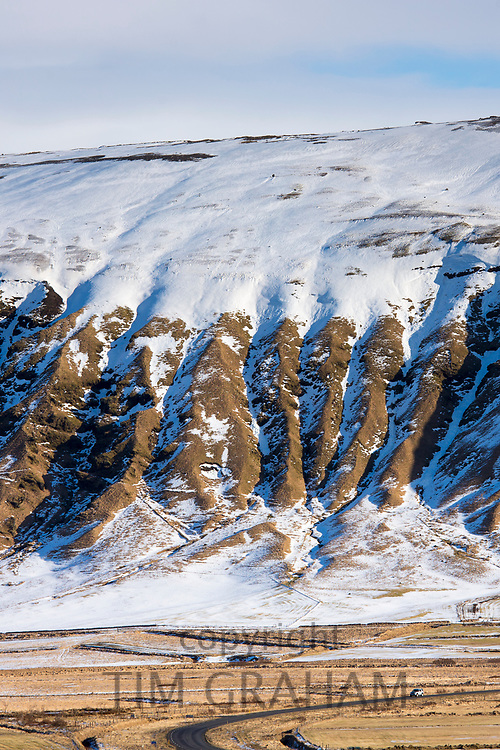 Snow-covered volcanic mountain in South Iceland