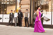 Men watch as lead dancer Jessica Grippo walks past.