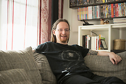 Portrait of man relaxing on couch