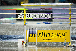 Javelin Throw postponed fo 40 min during Rain pours down during the 2009 IAAF Athletics World Championships on August 21, 2009 in Berlin, Germany. (Photo by Vid Ponikvar / Sportida)