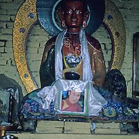Asia, Nepal, Kathmandu. Altar with photo of the Dalai Lama at Swayambhunath Stupa in Nepal.