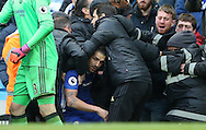 Cesc Fabregas of Chelsea is rescued after being pushed into the crowd during the Premier League match at the Etihad Stadium, Manchester. Picture date: December 3rd, 2016. Pic Simon Bellis/Sportimage