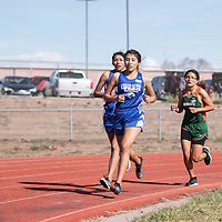 Girls competing in the 3200 meter race at the Wingate Invitational track meet, Saturday, April 6 in Fort Wingate.