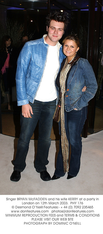 Singer BRYAN McFADDEN and his wife KERRY at a party in London on 12th March 2003.PHY 176