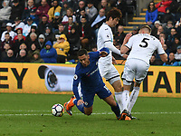 Football - 2017 / 2018 Premier League - Swansea City vs. Chelsea<br /> <br /> Eden Hazard of Chelsea collides with Ki Sung-yueng of Swansea City & goes down in the penalty area , at the Liberty Stadium.<br /> <br /> <br /> COLORSPORT/WINSTON BYNORTH