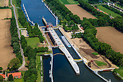 Nederland, Limburg, Gemeente Maasgouw, 27-05-2013; ingang Lateraalkanaal LInne-Buggenum, met sluis Heel. Sluiskolk wordt verbreed. De kleinere sluis (re) is Linne, deze geeft toegang tot de Maasplassen.<br /> Entrance Meuse Lateral Canal Linne-Buggenum. Lock chamber is widened. Acces to Meuse and Meuse-lakes near Roermond.<br /> luchtfoto (toeslag op standaardtarieven);<br /> aerial photo (additional fee required);<br /> copyright foto/photo Siebe Swart.