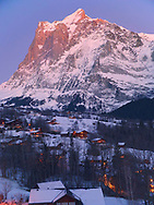 Blue hour in the alps with the lights beginning to light up this ski village in Switzerland.