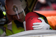 A volunteer casualty is helped by a medic during a London Fire Brigade's 'extrication' team's demonstration with the Vehicle and Operator Services Agency (VOSA) on how firefighters rescue passengers by cutting open with dedicated cutting equipment a stretch limousine in London's Covent Garden Piazza. Highlighting the dangers of hiring illegal luxury or novelty cars, this vehicle was seized last year with many mechanical defects rendering it unsafe for those inside with limited exit doors. Of 358 cars stopped in March 2012, 27 were seized and 232 given prohibitions. This scenario is a simulation and therefore reproduces the reality of an emergency, using real emergency services personnel and equipment. Casualties are volunteers and none were injured in the making of this photograph.