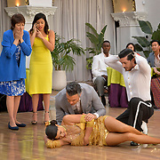 """Jane The Virgin -- """"Chapter Seventy-Six"""" -- Image Number: JAV412a_0024.jpg -- Pictured (L-R): Ivonne Coll as Alba, Gina Rodriguez as Jane, Jaime Camil as Rogelio, Andrea Navedo as Xo and George Akram as Brad -- Photo: Lisa Rose/The CW -- © 2018 The CW Network, LLC. All Rights Reserved."""