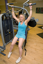 Woman using Multigym weights at Southglade Leisure Centre; Nottingham