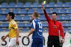 Dalibor Volas of Nafta and referee Dejan Balazic at the football match between NK Nafta Lendava and NK Luka Koper of PrvaLiga league on May 16, 2010 in Lendava, Slovenia. Nafta lost 1 : 2, Koper became National champion.  (Photo by Urban Urbanc / Sportida)