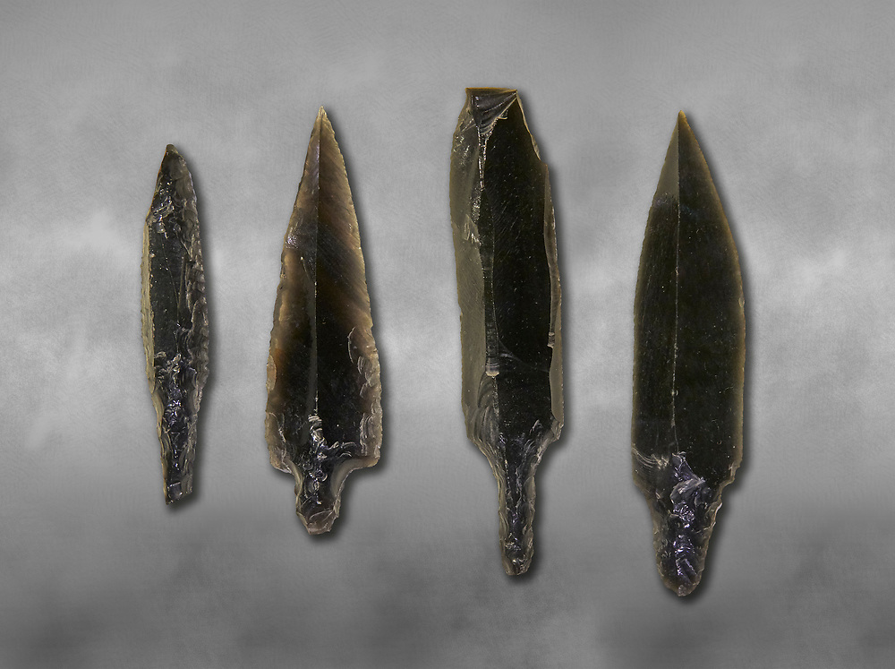 Black obsidian arrow heads. Catalhoyuk Collections. Museum of Anatolian Civilisations, Ankara. Against a gray mottled background .<br /> <br /> If you prefer you can also buy from our ALAMY PHOTO LIBRARY  Collection visit : https://www.alamy.com/portfolio/paul-williams-funkystock/prehistoric-neolithic-art.html - Type Catalhoyuk into the LOWER SEARCH WITHIN GALLERY box. Refine search by adding background colour, place, museum etc.<br /> <br /> Visit our PREHISTORIC PLACES PHOTO COLLECTIONS for more  photos to download or buy as prints https://funkystock.photoshelter.com/gallery-collection/Prehistoric-Neolithic-Sites-Art-Artefacts-Pictures-Photos/C0000tfxw63zrUT4