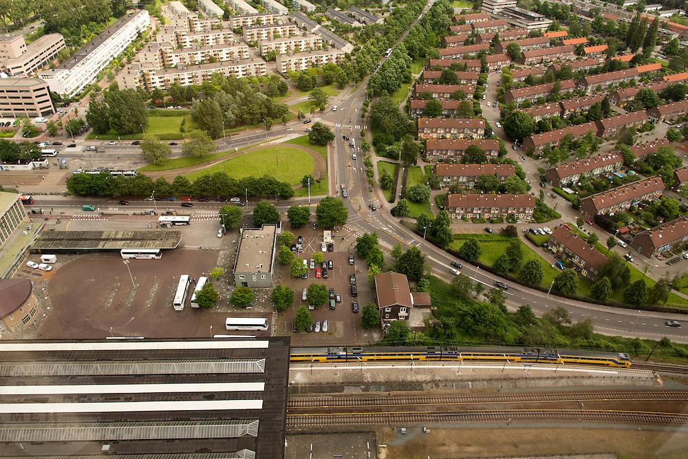 Uitzicht op Amsterdam vanaf de Rembrandt-toren bij Amsterdam Amstel. Onderaan is station Amsterdam Amstel te zien.<br /> <br /> Amsterdam from above, with on the lower half train station Amsterdam Amstel.
