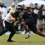 ORLANDO, FL - NOVEMBER 21:  Joel Dublanko #41 of the Cincinnati Bearcats stops a charging Marlon Williams #6 of the Central Florida Knights at Bounce House-FBC Mortgage Field on November 21, 2020 in Orlando, Florida. (Photo by Alex Menendez/Getty Images) *** Local Caption *** Joel Dublanko; Marlon Williams