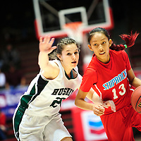 031413  Adron Gardner/Independent<br /> <br /> Hope Chrisitan Husky Marissa Pery (23) follows Shiprock Chieftain Shania Harry (13) on a drive during the 3A New Mexico High School Basketball tournament semifinals at The Pit in Albuquerque Thursday.