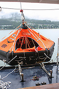 Abandon Ship Drill. lift raft This vessel, for use in an emergency if the crew and passengers have to abandon ship, is lowered to the surface of the sea The passengers and crew than enter the lifeboat or raft. This is a drill to test the crew's response to such a situation