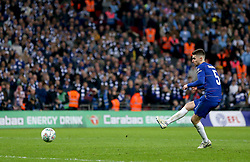 Chelsea's Jorginho takes a shot at a penalty but sees it saved by Manchester City goalkeeper Ederson in the penalty shoot out during the Carabao Cup Final at Wembley Stadium, London.
