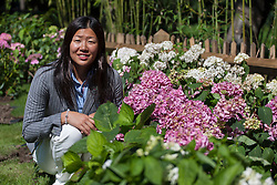 © licensed to London News Pictures. London, UK 24/07/2012. Japanese Olympic swimmer Izumi Kato posing at the Fukushima Garden opening ceremony in Holland Park, London. 22 year-old swimmer will be racing for 200m in the Olympics. Photo credit: Tolga Akmen/LNP