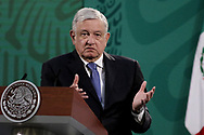 MEXICO CITY, MEXICO - FEBRUARY 12: Mexico's President Andres Manuel Lopez Obrador gesticulates during the daily morning press conference at National Palace on February 12, 2021 in Mexico City, Mexico