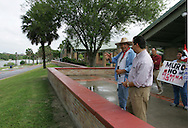 Jay Johnson Castro talks with Brownsville Mayor Eddie Trevino after arriving at Brownsville's Dean Porter Park, the end of his 200+ mile journey.