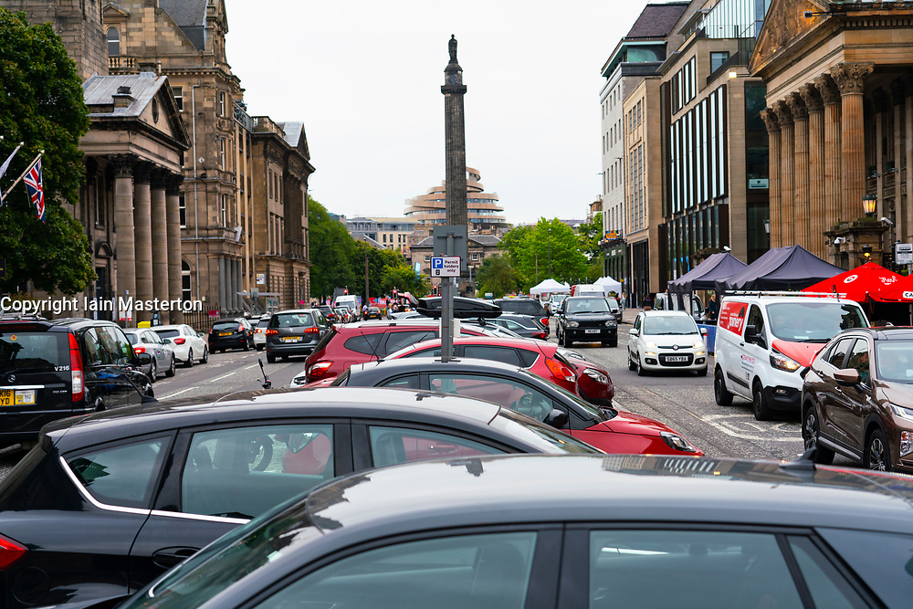 Edinburgh, Scotland, UK. 19th August  2021. Edinburgh City Council plan to close George Street in Edinburgh to traffic and make it accessible for pedestrians and cyclists only.  The plans form part of Edinburgh City Council's ten-year transformation project, which will see the city centre become largely car-free by 2030. Pic; Cars are parked along both sides and in middle of George Street at the moment.  Iain Masterton/Alamy Live news.