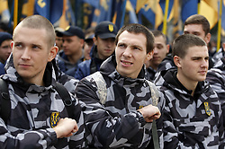October 2, 2018 - Kiev, Ukraine - Ukrainian activists of Ukrainian nationalist groups in support of foreign citizens volunteers, who joined Ukrainian armed forces and military self-defence battalions and took part in a military conflict in eastern Ukraine, in front the Parliament in Kiev, Ukraine, 2 October 2018. Activists demand a simplified procedure for obtaining Ukrainian citizenship for volunteers foreign citizens, a migration amnesty  and a moratorium of their extradition. (Credit Image: © Serg Glovny/ZUMA Wire)