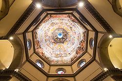 """THEMENBILD - Die Kathedrale Santa Maria del Fiore (italienisch Cattedrale di Santa Maria del Fiore) in Florenz ist die Bischofskirche des Erzbistums Florenz und somit Metropolitankirche der Kirchenprovinz Florenz. Ihre gewaltige weltbekannte Kuppel, das Hauptwerk Brunelleschis, gilt als technische Meisterleistung der frühen Renaissance. Hier im Bild Fresko von Giorgio Vasari in der Kuppel von Filippo Brunelleschi. Vasari hat 1572 dieses Fresko begonnen, das 1579 von Federico Zuccari vollendet wurde. Es ist in seinen Ausmaßen riesig und gilt als der flächenmäßig größte Fresken-Zyklus zu einem christlichen Thema. Hunderte von Kolossalfiguren gruppieren sich auf insgesamt 4000 m² um den Weltenrichter herum, den man in der unteren Mitte mühsam erkennen kann. Vasaris Traum soll es gewesen sein, Michelangelos """"Jüngstes Gericht"""" in der Sixtinischen Kapelle zu übertreffen.. Aufgenommen am 18. Oktober 2015 // SThe Cattedrale di Santa Maria del Fiore (English, """"Cathedral of Saint Mary of the Flower"""") is the main church of Florence, Italy. Il Duomo di Firenze, as it is ordinarily called, was begun in 1296 in the Gothic style to the design of Arnolfo di Cambio and completed structurally in 1436 with the dome engineered by Filippo Brunelleschi. The exterior of the basilica is faced with polychrome marble panels in various shades of green and pink bordered by white and has an elaborate 19th-century Gothic Revival façade by Emilio De Fabris. The cathedral complex, located in Piazza del Duomo, includes the Baptistery and Giotto's Campanile. The three buildings are part of the UNESCO World Heritage Site covering the historic centre of Florence and are a major attraction to tourists visiting the region of Tuscany. The basilica is one of Italy's largest churches, and until development of new structural materials in the modern era, the dome was the largest in the world. It remains the largest brick dome ever constructed.. Pictured on 18. October 2015. EXPA Pictures © 2"""