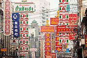 07 OCTOBER 2009 -- BANGKOK, THAILAND: Street signs over Yaowarat Road, in the heart of Chinatown in Bangkok, Thailand. Chinatown is the old commercial heart of Bangkok with thousands of small shops selling everything from clothes to dried fish to case lots of shoes and gem stones.   Photo By Jack Kurtz