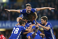 GOAL/CELE  :  Ngolo Kante of Chelsea celebrates after scoring his sides 4th goal with his team mates including Gary Cahill of Chelsea who jumps on top of the group. Premier league match, Chelsea v Manchester Utd at Stamford Bridge in London on Sunday 23rd October 2016.<br /> pic by John Patrick Fletcher, Andrew Orchard sports photography.