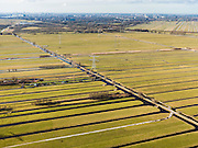 Nederland, Zuid-Holland, Gemeente Bergambacht, 20-02-2012; Krimpenerwaard met Polder Schuwacht, diagonaal de Tiendweg. De langwerpige verkaveling is ontstaan door het ontginnen van het veen vanuit de dorpen langs de rivier Lek - aan de horizon links. Het betreft zogenaamde pntginningen met vrije opstreek. Aan de horizon Krimpen a/d IJssel..Polder Schuwacht in the Krimpenerwaard. The land division (in lots) has been created by the reclamation of peat bog starting from the villages along the rivers..luchtfoto (toeslag), aerial photo (additional fee required);.copyright foto/photo Siebe Swart.