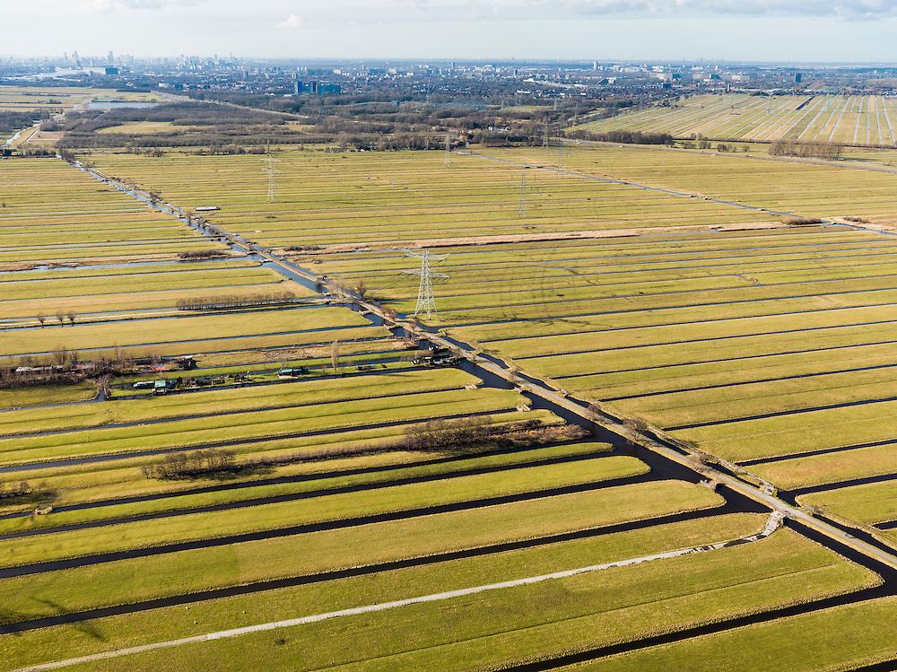 Nederland, Zuid-Holland, Gemeente Bergambacht, 20-02-2012; Krimpenerwaard met Polder Schuwacht, diagonaal de Tiendweg. De langwerpige verkaveling is ontstaan door het ontginnen van het veen vanuit de dorpen langs de rivier Lek - aan de horizon links. Het betreft zogenaamde pntginningen met vrije opstreek. Aan de horizon Krimpen a/d IJssel..Polder Schuwacht in the Krimpenerwaard. The land division (in lots) has been created by the reclamation of peat bog starting from the villages along the rivers..luchtfoto (toeslag), aerial photo (additional fee required);.copyright foto/photo Siebe Swart.