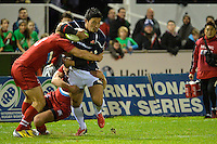 Conwy, UK. Friday, 15 November 2013<br /> Pictured: Ayumu Goromaru of Japan is tackled by Sergey Sugrobov and Dmitry Gerasimov of Russia<br /> Re: Japan v Russia rugby at Parc Eirias, Conwy, North Wales, United Kingdom.