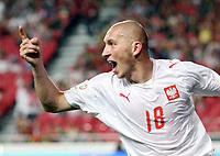 Fotball<br /> 08.09.2007<br /> EM-kvalifisering<br /> Portugal v Polen<br /> Foto: Wrofoto/Digitalsport<br /> NORWAY ONLY<br /> <br /> Jubel von Mariusz Lewandowski (POL)