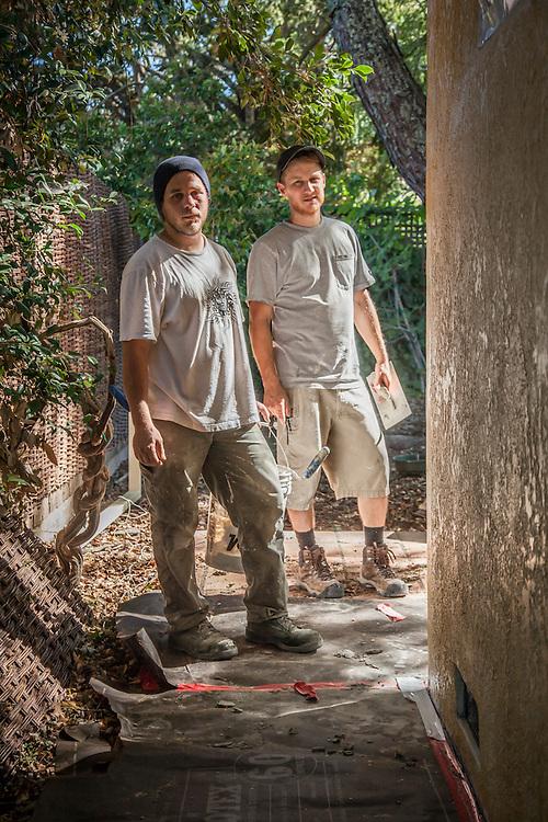 Concrete finish contractor Noah Torkelsen (right) with apprentice, Jake Allen, on a job site on School Street in Calistoga