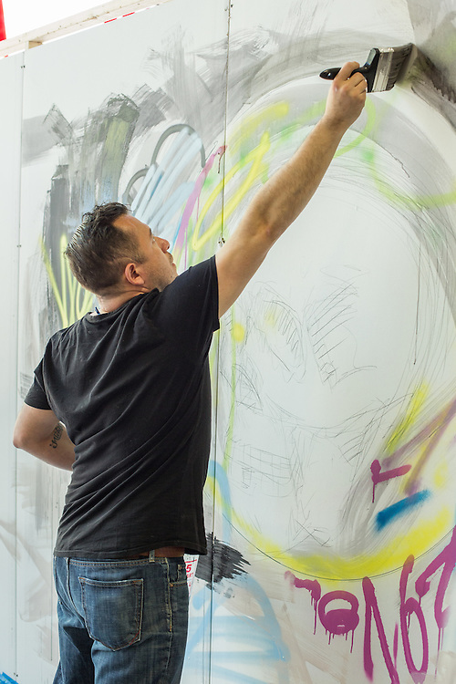 Painter Rodrigo Valles painting a large mural inside the BklynDesigns show, part of NYCxDesign, a week-long design festival in New York City.