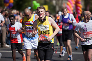 London, UK. Sunday 13th April 2014. Competitors running in the main public event of the Virgin Money London Marathon 2014. These runners take part and raise huge sums fo money for charity organisations.
