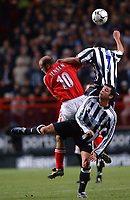 Claus Jensen (Charlton) Jermaine Jenas and Gary Speed (Newcastle) Charlton v Newcastle, The Valley, 20/12/2003, Premiership Football. Credit : Colorsport / Robin Hume. Digital File Only.
