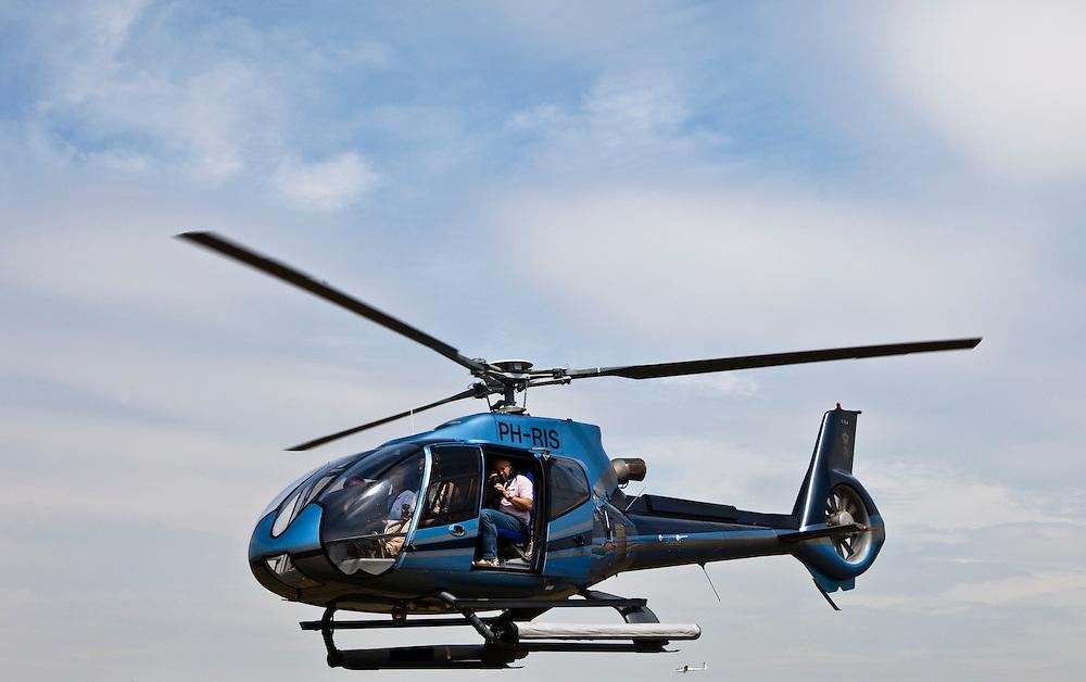 Nederland, Noord-Holland, Hilversum, 08-07-2010; .Eurocopter EC130, 6 persoons helikopter voorzien van turbomotor; de achterste deur is open voor cameraman / fotograaf..luchtfoto (toeslag), aerial photo (additional fee required).foto/photo Siebe Swart