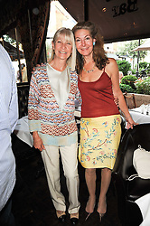 """Left to right, GRETA MORRISON and SANDRA CRONAN at a party to celebrate the publication of the Paper back edition of """"A Lion Called Christian"""" held at Julie's Restaurant & Bar, 135 Portland Road, London W11 on 28th June 2010."""
