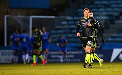 Rory Gaffney of Bristol Rovers cuts a dejected figure as Mark Byrne of Gillingham celebrates with teammates after scoring a goal to make it 1-0 - Mandatory by-line: Robbie Stephenson/JMP - 16/12/2017 - FOOTBALL - MEMS Priestfield Stadium - Gillingham, England - Gillingham v Bristol Rovers - Sky Bet League One
