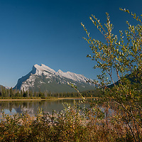 Visitors admire Vermillion Lakes in Banff National Park, Alberta, Canada. Mount Rundle rises in the background.