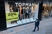 As the UK reacts to Prime Minister Boris Johnson's announcement of Lockdown 2 during the second wave of the Coronavirus pandemic, a man walks past male mannequins of a branch of clothing retailer Topshop, on 2nd November 2020, in London, England. From midnight on Thursday, all non-essential shops, bars, restaurants and other small businesses will have to closed, according to government Covid restrictions - and for a minimum of 4 weeks in the run-up to Christmas.
