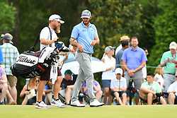 May 4, 2019 - Charlotte, NC, U.S. - CHARLOTTE, NC - MAY 04: Max Homa hands his putter to his caddie after finishing on the 5th green in round three of the Wells Fargo Championship on May 04, 2019 at Quail Hollow Club in Charlotte,NC. (Photo by Dannie Walls/Icon Sportswire) (Credit Image: © Dannie Walls/Icon SMI via ZUMA Press)