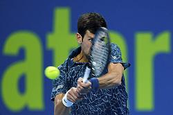 Novak Djokovic of Serbia returns the ball to Nikoloz Basilashvili of Georgia during their Quarter - Final of ATP Qatar Open Tennis match at the Khalifa International Tennis Complex in Doha, capital of Qatar, on January 03, 2019. Novak Djokovic won 2-1  (Credit Image: © Nikku/Xinhua via ZUMA Wire)