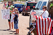 04 AUGUST 2010 -- GILBERT, AZ: L to R background to foreground: Holli Pearce (CQ Holli), her daughter Emalyn Pearce (CQ) 8, and son Nathen Pearce (CQ NATHEN) and Tamara Pew (CQ) and her granddaughter Kenzlie Figueroa (CQ), all  from Mesa, put their hands over their hearts as the Det. Carlos Ledesma's cortege passes at the funeral for Chandler police detective Carlos Ledesma Wednesday. Kenzlie is the daughter of fallen Phoenix Police Officer Shane Figueroa. Ledesma was killed during a shoot out with suspected drug dealers during an undercover operation in south Phoenix Wednesday July 28.  PHOTO BY JACK KURTZ