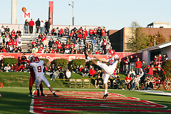 15 October 2011: Cole Zwiefelhofer punts from the end zone during an NCAA football game between the University of South Dakota Coyotes and the Illinois State Redbirds (ISU) at Hancock Stadium in Normal Illinois.